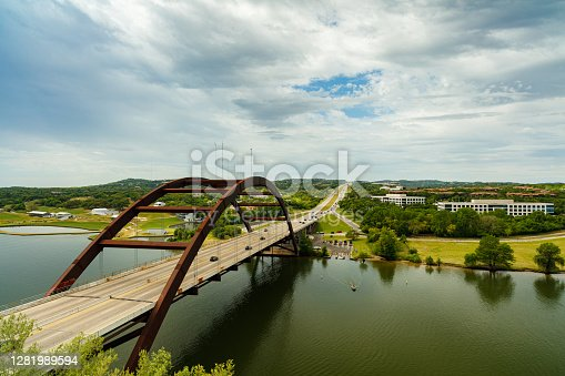 Pennybacker Bridge over the Colorado River in Austin, Texas on a cloudy day.