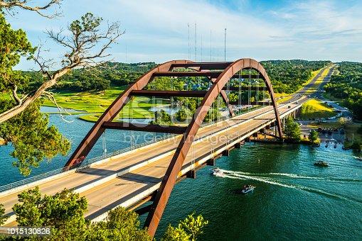 501329818istockphoto Pennybacker Bridge Classic View Summer Time with Boat going under bridge 1015130826