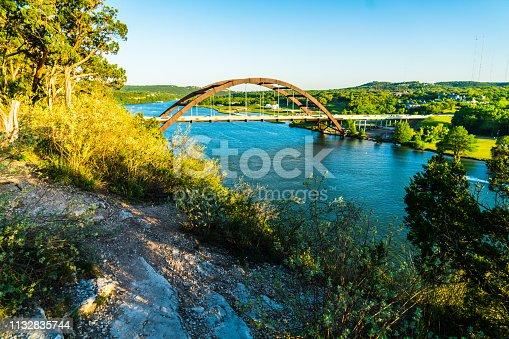 501329818istockphoto Pennybacker bridge cliff side view in Austin Texas 1132835744