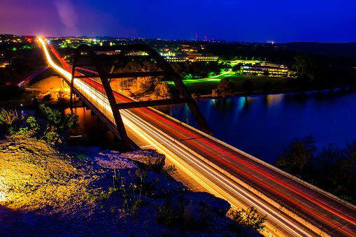 istock Pennybacker Bridge or 360 bridge Long Exposure with Cliff Lit up 470603782