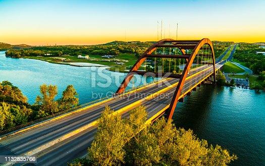 501329818istockphoto Pennybacker bridge or 360 Bridge sunset golden hour colors 1132835766