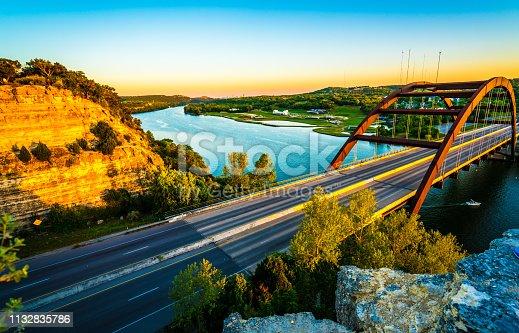 501329818istockphoto Pennybacker bridge or 360 Bridge sunset golden hour colors 1132835786