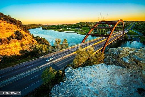 501329818istockphoto Pennybacker bridge or 360 Bridge sunset into the new Austin Texas 1132835787