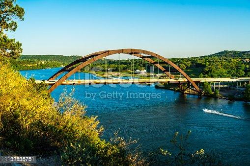 501329818istockphoto Pennybacker brigs or 360 Bridge side angle with boat going under bridge 1132835751