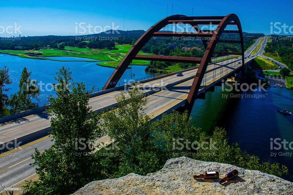 Pennybacker or 360 Bridge Mid Day with Beer Bottles Foreground stock photo