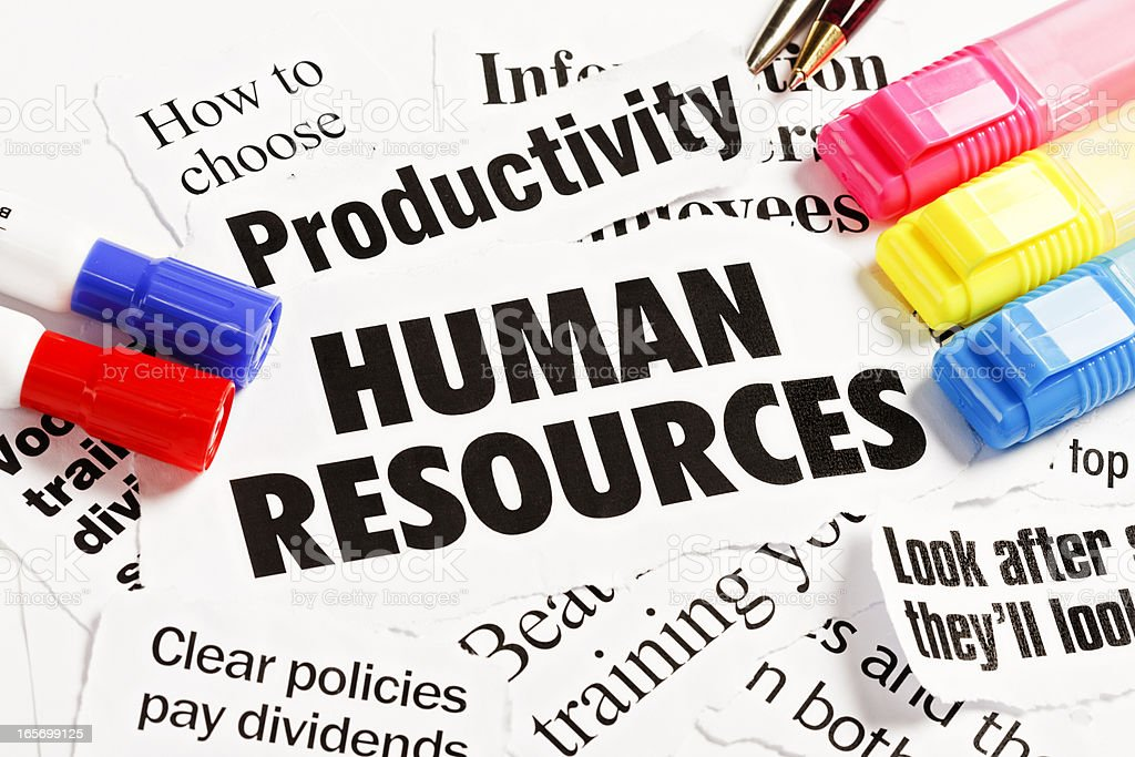 Pens hold down press cuttings on human resources and productivity royalty-free stock photo