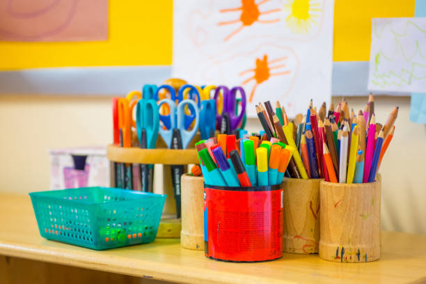 Pens on the kindergarten desk Colouring pens, scissors, pencils on the table in nursery school supplies stock pictures, royalty-free photos & images
