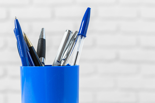 pens or writing tools on white table