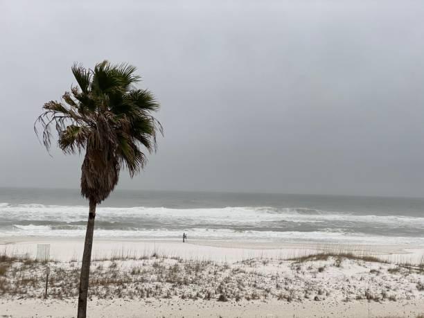 Pensacola Beach, FL, USA: Waves crashing on Pensacola Beach on overcast day stock photo