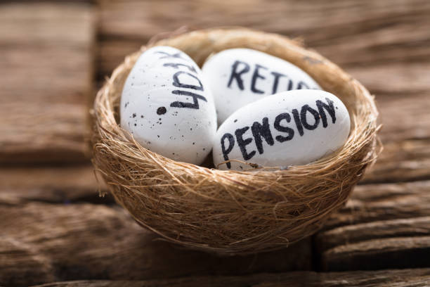Pension  401K And Retire Written On White Eggs In Nest stock photo