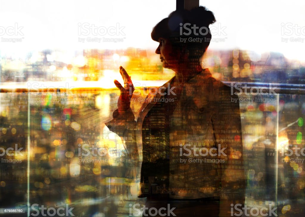 Pension age good looking woman against of window and city view. royalty-free stock photo