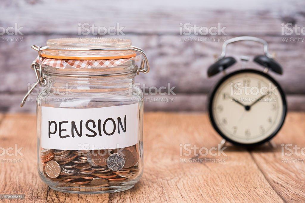 Pension savings fund A pension savings glass jar Assistance Stock Photo