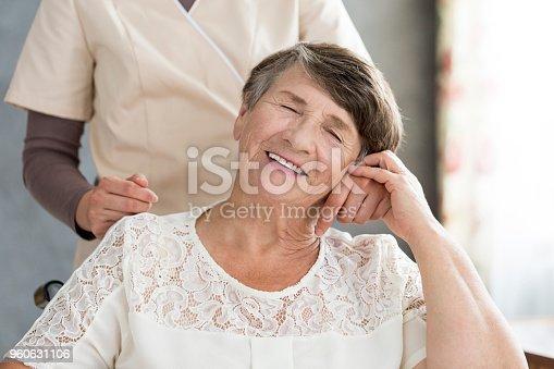 istock Pensioner holding hand of nurse 960631106