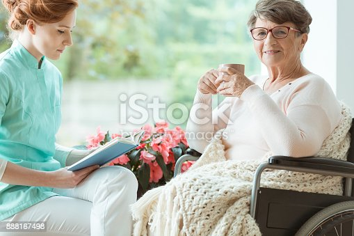 istock Pensioner on wheelchair sick on osteoporosis 888167498
