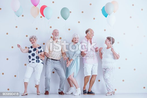 istock Pensioners dancing at party 905890418