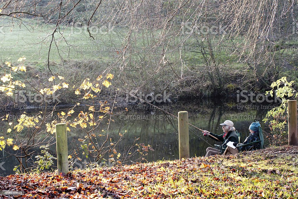 pensioners fishing beside river royalty-free stock photo