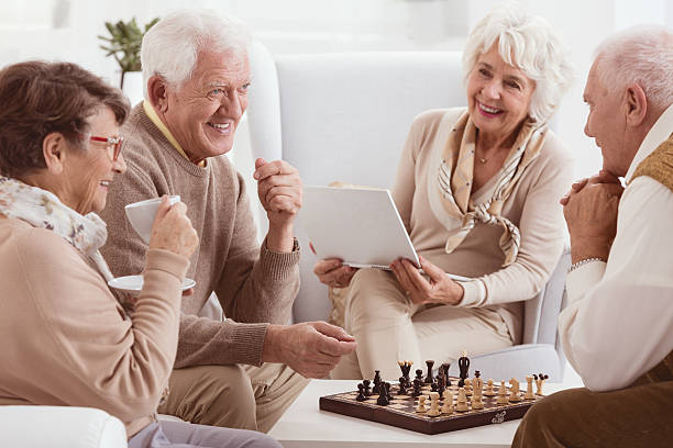 pensioners playing chess - game of life stock photos and pictures