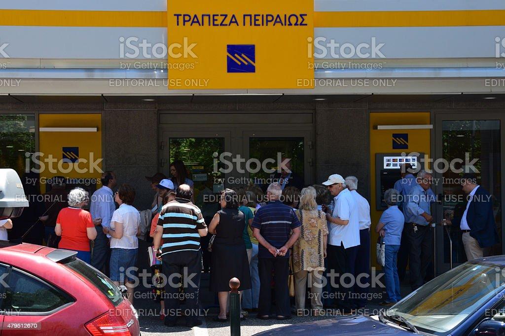 pensioners queue at greek bank stock photo