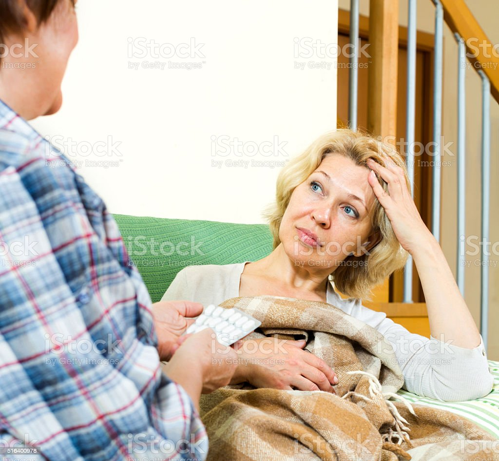 pensioners talking about medical preparations stock photo