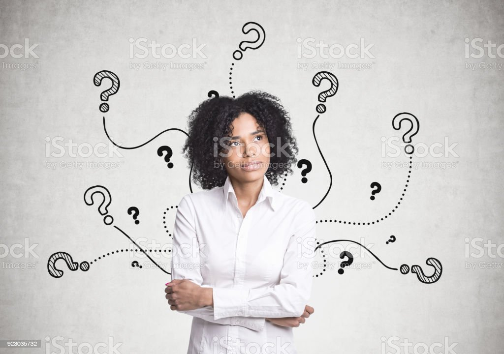 Pensive African American businesswoman, questions stock photo