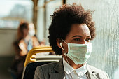 istock Pensive African American businesswoman with protective mask traveling by bus. 1213801592