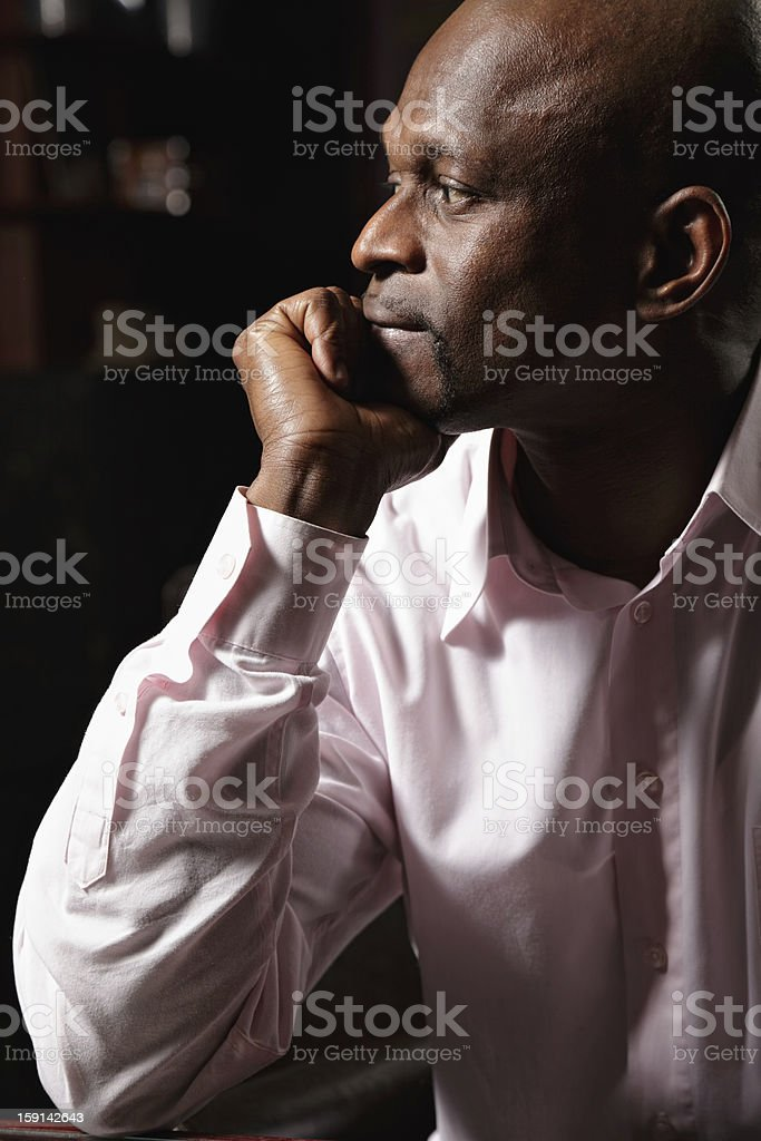 Pensive african man sideview stock photo