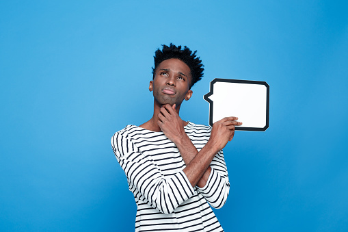 Pensive Afro American Guy Holding Speech Bubble Stock Photo - Download Image Now