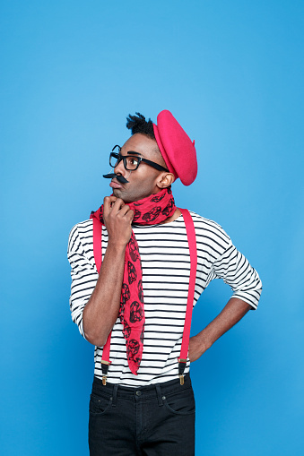 Pensive Afro American Guy In A French Outfit Stock Photo - Download Image Now
