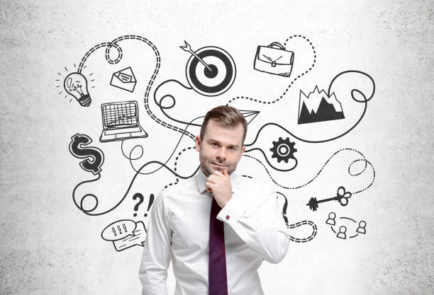 Pensive bearded man and a business plan - foto stock