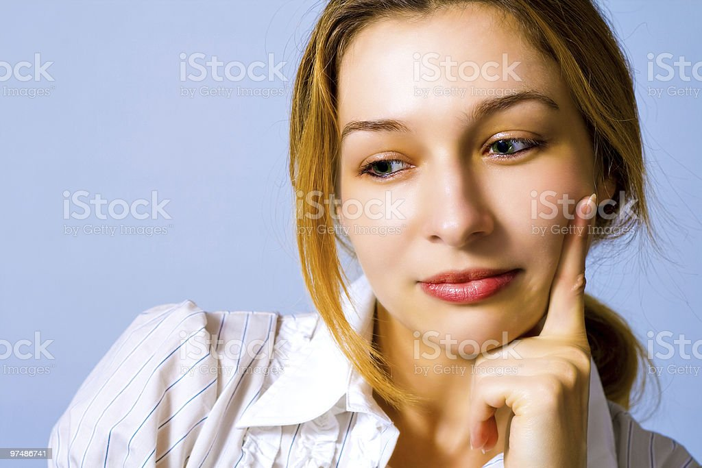 Pensive beautiful young woman royalty-free stock photo