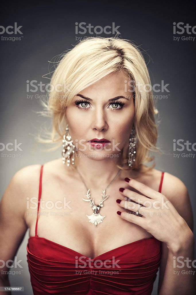 Pensive blond woman dressed up royalty-free stock photo