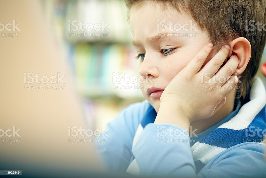 Pensive boy royalty-free stock photo