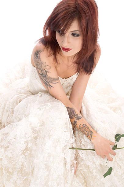 nachdenklich braut mit tattoos auf weiß - brautkleid trägerlos stock-fotos und bilder