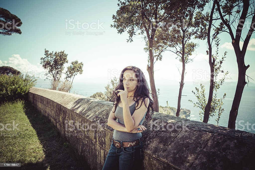 Pensive Brunette Woman in a Park royalty-free stock photo