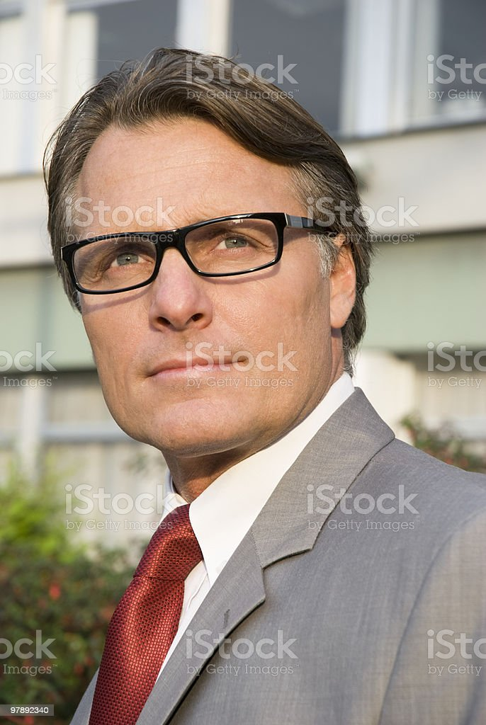 Pensive businessman in spectacles. royalty-free stock photo