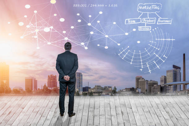 Pensive businessman looking at interface against city background stock photo