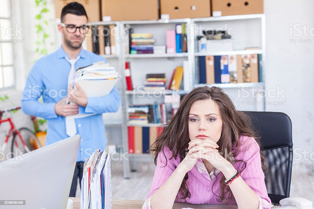 Pensive businesswoman having problems in work stock photo
