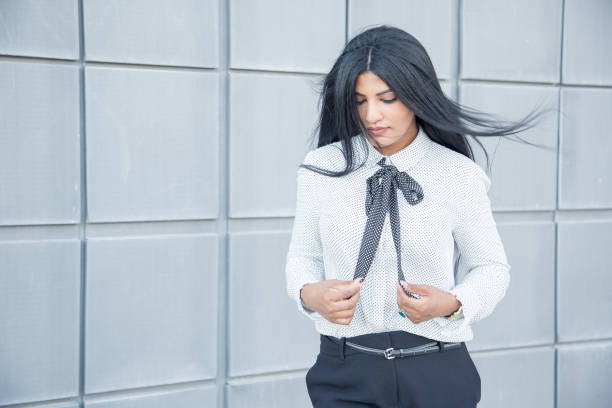 Pensive calm businesswoman with hair blown by wind stock photo