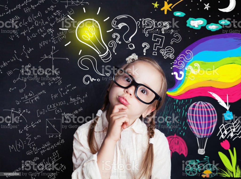 Pensive child school student with yellow lightbulb and school and childhood supplies design elements. Child ideas and development concept stock photo