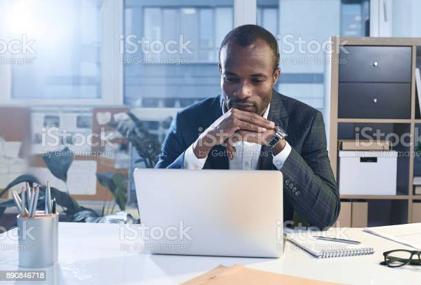 Pensive Confident Businessman Is Working On Smart Gadget Stock Photo - Download Image Now