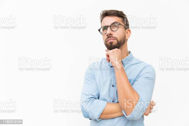 Photo of Pensive customer thinking over special offer
