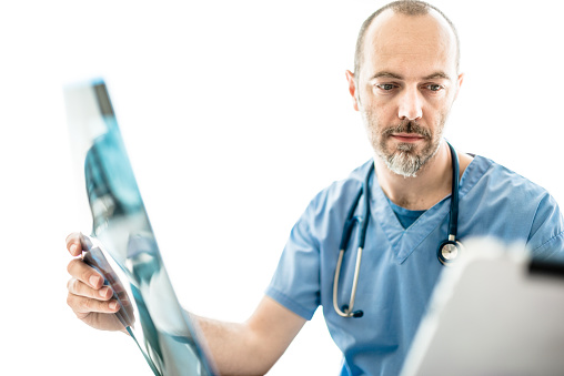 Pensive Doctor Looking The Xray Stock Photo - Download Image Now