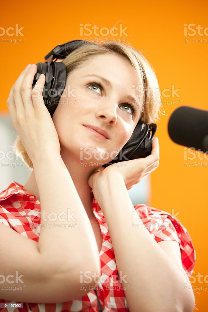 pensive female singer in studio royalty-free stock photo