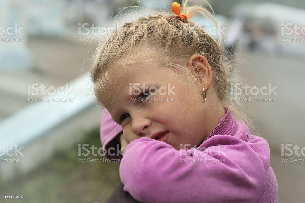 portrait of a sad little blonde girl