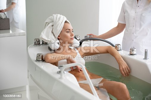 istock Pensive girl relaxing during procedure 1000858180