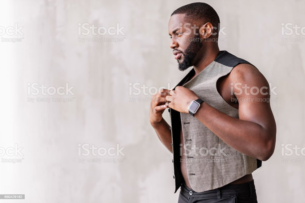 Pensive handsome trendy man wearing chic clothes stock photo