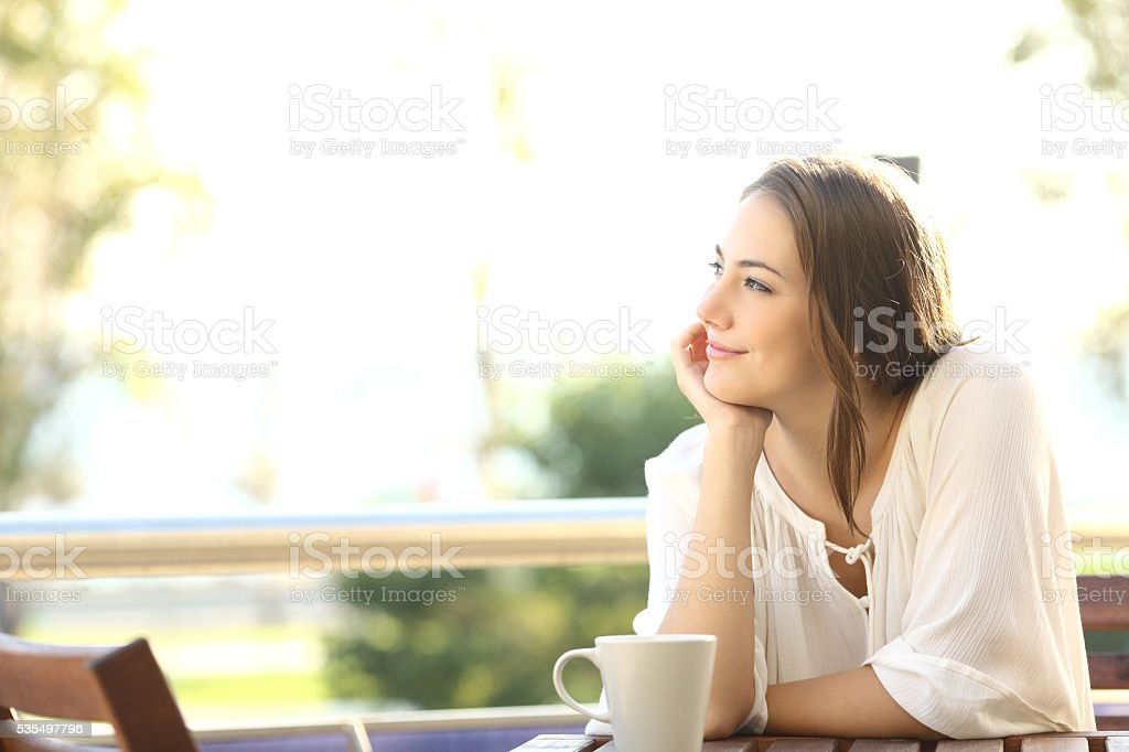 Pensive happy woman remembering stock photo