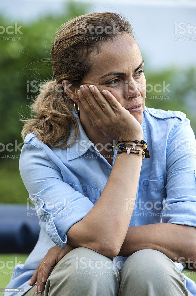 Pensive hispanic mature  woman royalty-free stock photo
