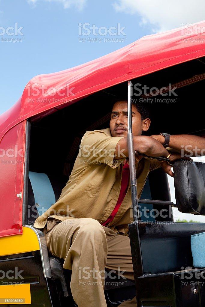 Pensive Indian Auto Rickshaw Driver royalty-free stock photo