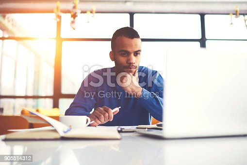 istock Pensive international afro american student watching training webinar on laptop computer improving skills and knowledge, concentrated dark skinned freelancer pondering on completing working tasks 905514312